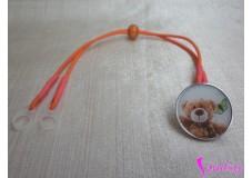 obrázek Záchytný klip na sluchadla nebo procesor/y - Oranžový medvídek