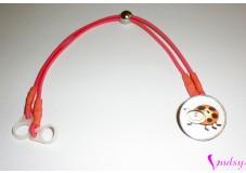 obrázek Záchytný klip na sluchadla nebo procesor/y - Bílá beruška